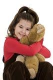Child holding teddy bear Stock Photos