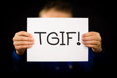 Child holding TGIF sign Stock Photo