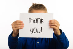 Child holding Thank You sign Royalty Free Stock Images