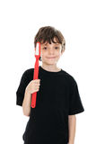 Child holding toy toothbrush Stock Photography