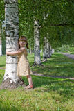 Child holding tree Stock Images