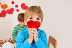 Child Holding Valentine's Day Hearts Stock Image