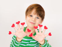 Child Holding Valentine's Day Hearts Stock Photo