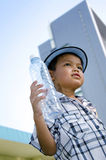 Child holding a water bottle Stock Photography