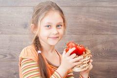 Child holding a wicker basket Stock Photo