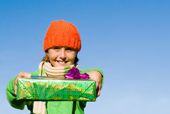 Child holding wrapped gifts Royalty Free Stock Photos