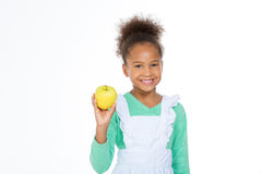 Child holding a yellow apple Royalty Free Stock Photos