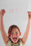 Child holding YES sign Stock Photos