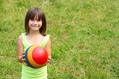The child holds a ball Stock Photo