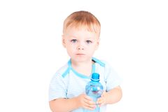 Child holds a bottle of water Royalty Free Stock Image