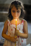A child holds a candle in hands Royalty Free Stock Image