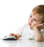 Child holds the computer mouse Royalty Free Stock Images