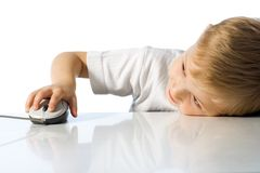 Child holds the computer mouse Stock Images