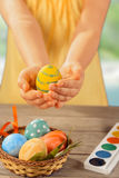 Child holds Easter egg Stock Photos