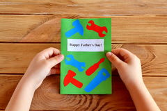 Child holds fathers day greeting card in his hands. Royalty Free Stock Photo