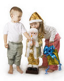 Child holds gift and kisses Santa Royalty Free Stock Photo