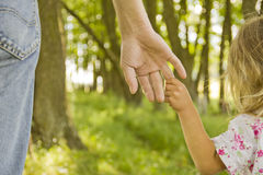Child holds the hand of parent Royalty Free Stock Photo