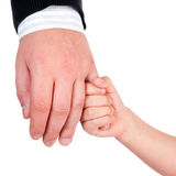 Child holds his father's hand. Isolated on a white background Royalty Free Stock Image