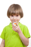 Child holds  japanese roll Royalty Free Stock Images
