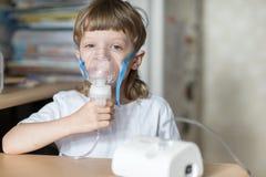 Child holds a mask vapor inhaler Royalty Free Stock Images