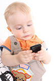 The child holds a mobile phone in hands Royalty Free Stock Photos