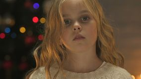 Child holds out hand to camera, concept of help or orphan adoption at Christmas. Stock footage stock video footage