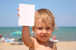 The child holds a paper Stock Photo