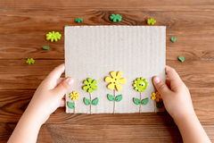 Child holds paper greeting card in his hands Royalty Free Stock Photos