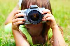 The child holds the photocamera Stock Images