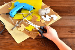 Child holds the scissors in his hands and does summer crafts with felt butterflies and flowers Stock Photography