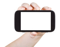 Child holds smart phone with cut out screen Royalty Free Stock Photos