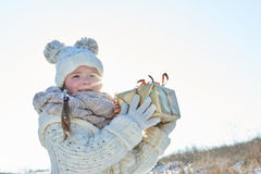 Child holds surprise gift. Child holds surprise christmas gift with joy Royalty Free Stock Photo