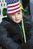 Child holds US Flag, St. Patrick's Day Parade, 2014, South Boston, Massachusetts, USA Stock Photos