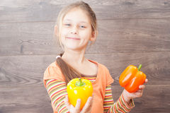 Child holds vegetables Royalty Free Stock Photos
