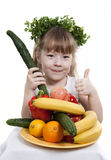 Child holds vegetables and fruit. Royalty Free Stock Images