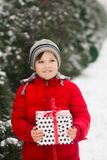 The child holds a xmas new year gift in his hands stock image