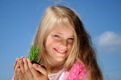 A child holds a young plant Royalty Free Stock Photography