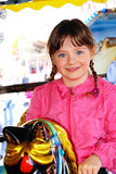 Child, holidays,  roundabout,  whirligig. The child smiles nicely. She rolls on the carousel in the Children's Park Stock Image