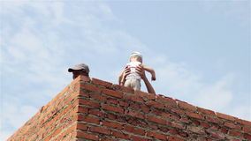 Child in home construction. Child safety in construction the house and childcare grandfather stock footage