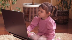 A child at home with a laptop. stock video footage