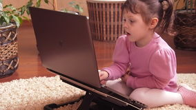 A child at home with a laptop. stock footage