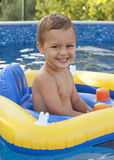 Child in home swimming pool Stock Photography