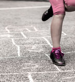 Child on the hopscotch Royalty Free Stock Image