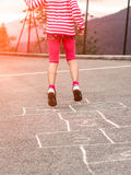 Child on the hopscotch Stock Photography