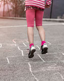 Child on the hopscotch Stock Images