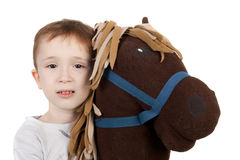 Child and horse. Cute little kid with the plush toy horse Royalty Free Stock Images