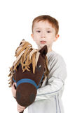 Child with horse. Cute little kid with the plush toy horse Royalty Free Stock Images