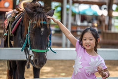 Child with Horse in Farm Royalty Free Stock Photography