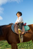 Child with a horse. Stock Photos