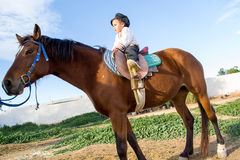 Child with a horse. Stock Image